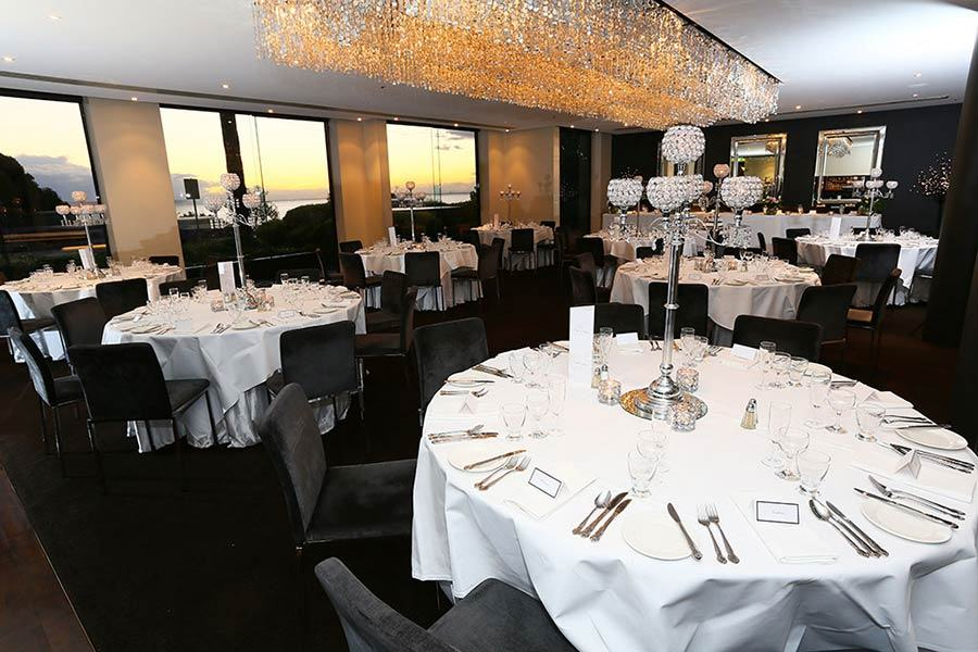 Photo of decorated tables for wedding reception at the Seaview Room, Brighton Savoy