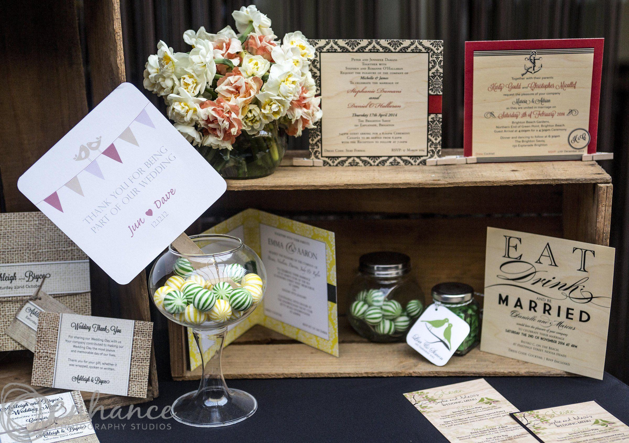 Photo of a wedding invitation display, featuring various wedding invitation styles