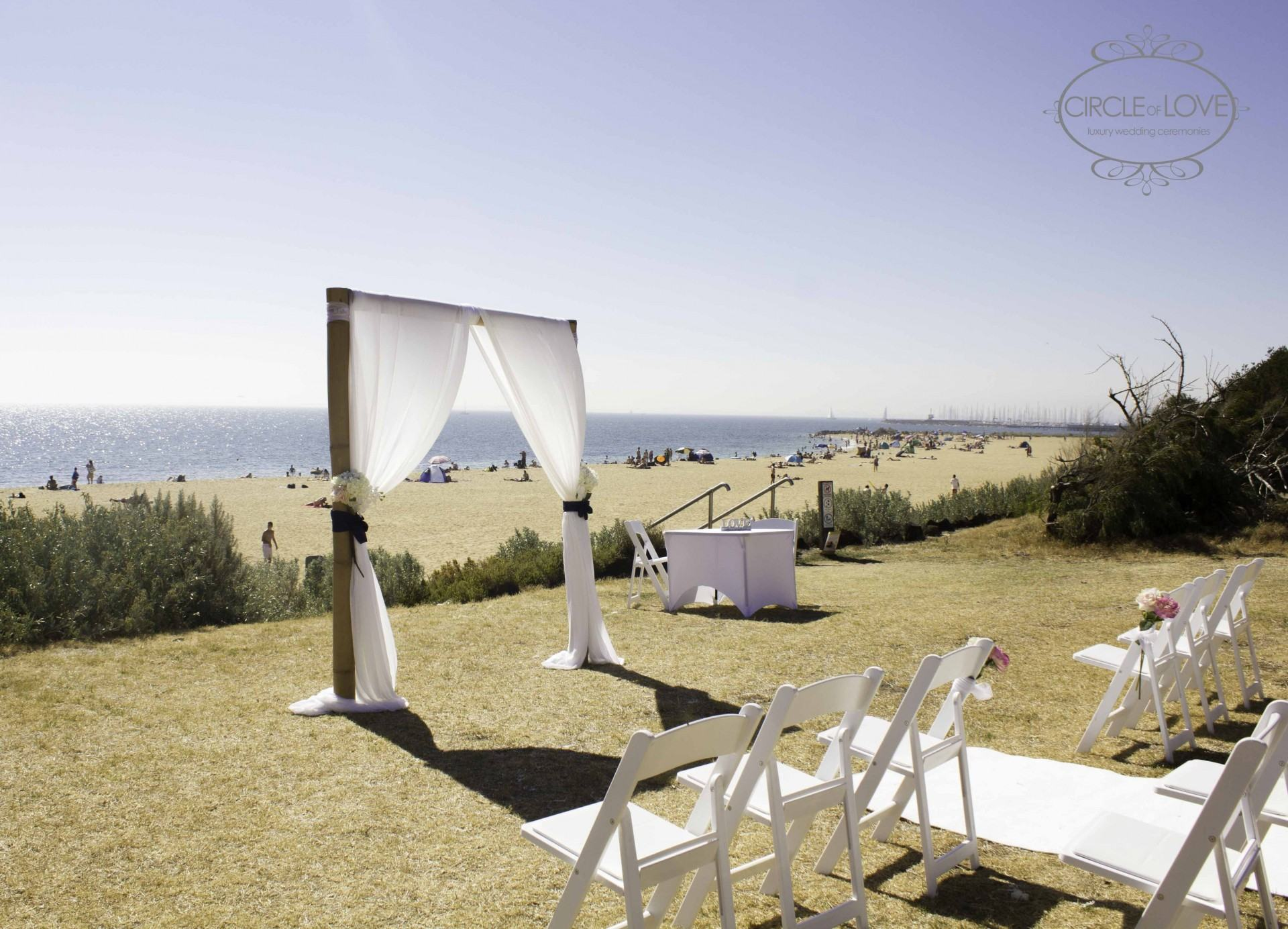 Photo of a wedding ceremony set up by the beach