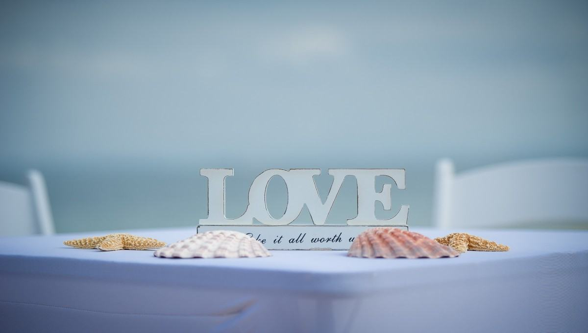 Table centrepiece made up of shells and the word LOVE