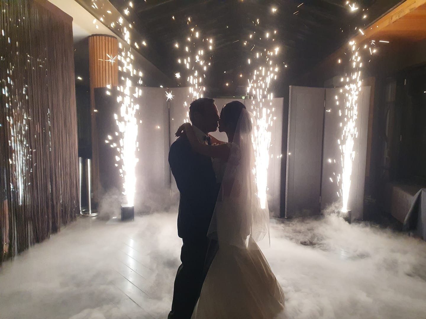 Wedding Couple Kissing with Fireworks