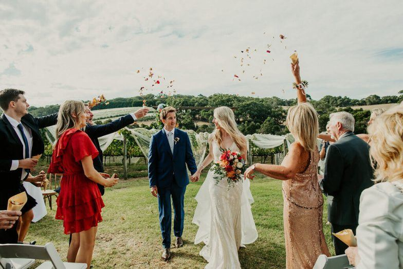 Wedding couple having rose petals thrown on